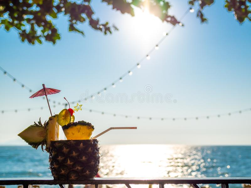 Pineapple juice cocktail near the beach in summer stock images