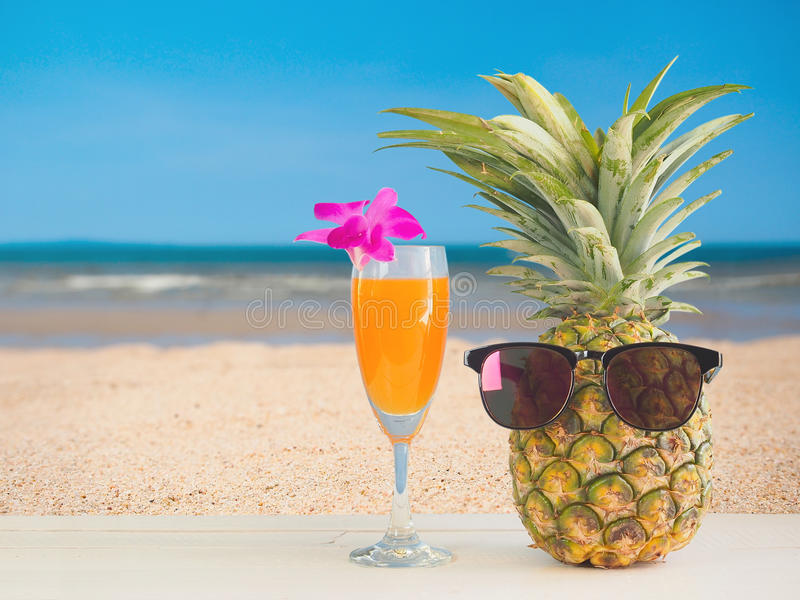 Pineapple juice with sea beach background. royalty free stock photography