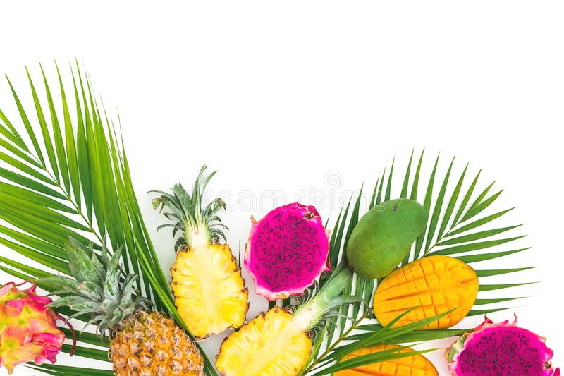 Pineapple, mango and dragon fruits on white background. Tropical fruits. Flat lay. Top view stock image
