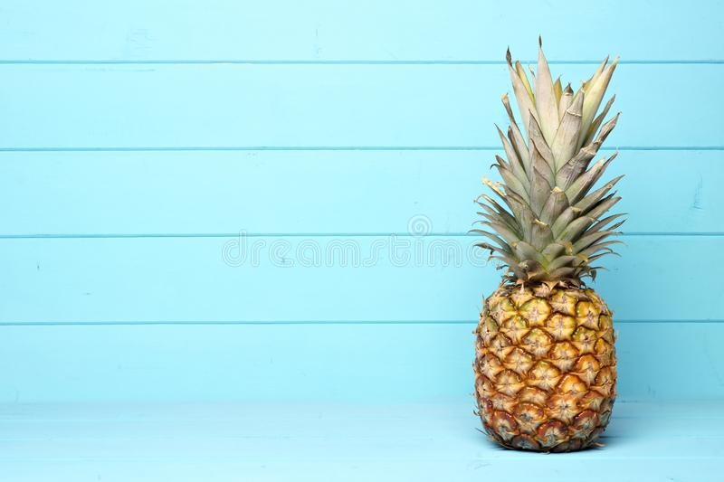 Pineapple on a pastel blue wood background royalty free stock photo