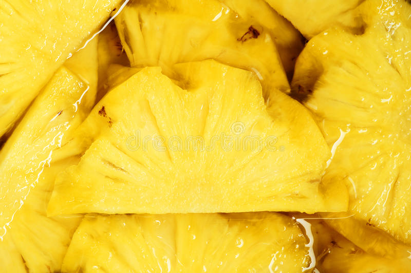 Pineapple pieces. The close-up of pineapple pieces royalty free stock photography