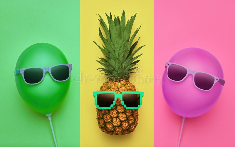 Pineapple. Air Balloon. Summer.Minimal Fun. Pineapple and Pink air Balloon. Bright Summer Color, Accessories. Tropical Hipster with Sunglasses. Creative Art stock photography