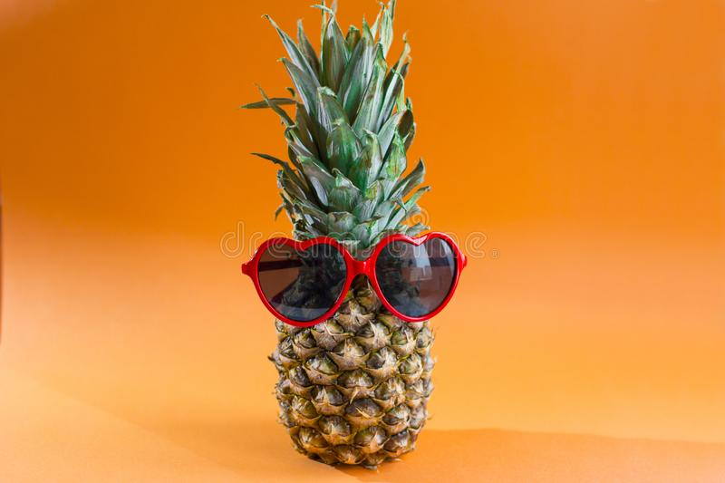 Pineapple series with sunglasses on yellow blue and pink background. Cool berry stock images