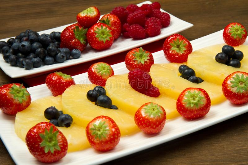 Download Pineapple Slices With Berries Stock Image - Image of sweet, wooden: 22415597