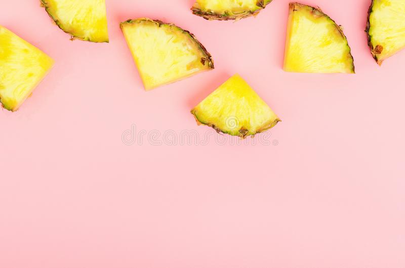 Pineapple slices on a pink background. Tropical juicy exotic healthy fruit. Copy space, top view, flat lay. stock photos