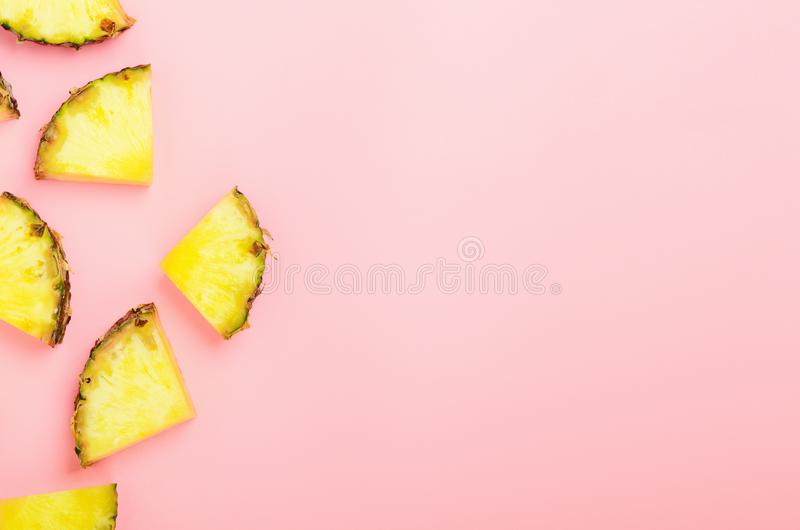 Pineapple slices on a pink background. Tropical juicy exotic healthy fruit. Copy space, top view, flat lay royalty free stock images