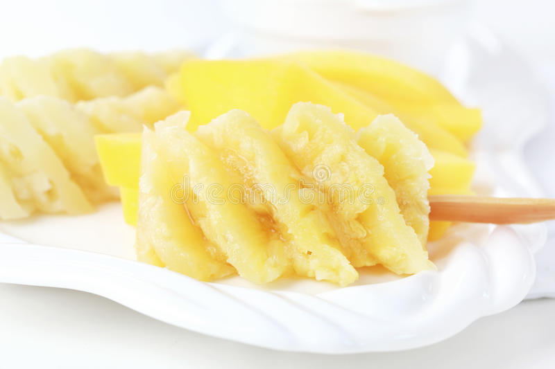 Download Pineapple on stick stock photo. Image of juicy, pineapple - 25115400