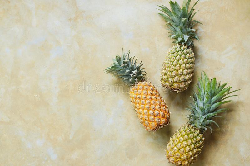 Pineapple on Stone Table Background Top Down View royalty free stock photo
