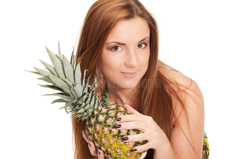 Pineapple summer. Girl in pineapple-like dress with pinapple in hands royalty free stock image