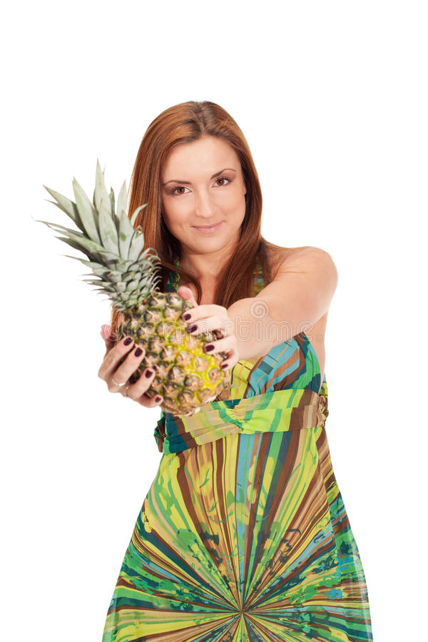 Pineapple summer. Girl in pineapple-like dress with pinapple in hands stock photo