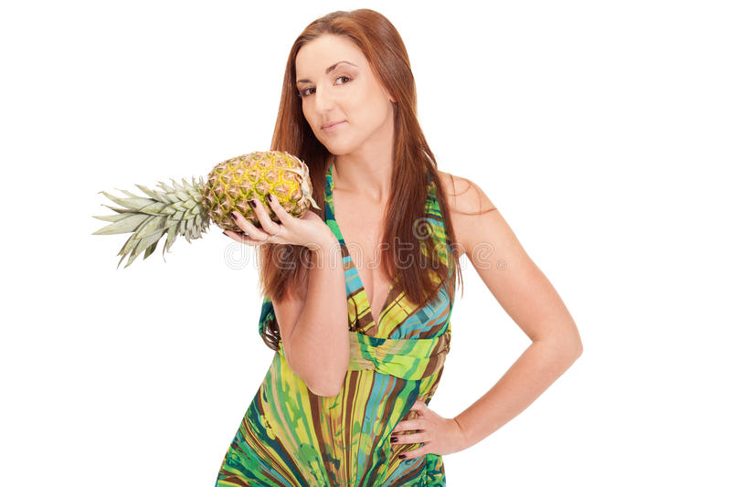 Pineapple summer. Girl in pineapple-like dress with pinapple in hands royalty free stock images