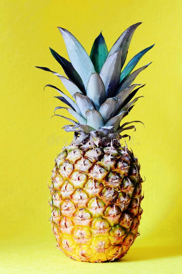 Pineapple on a yellow background. Beach and tropical theme. stock photography