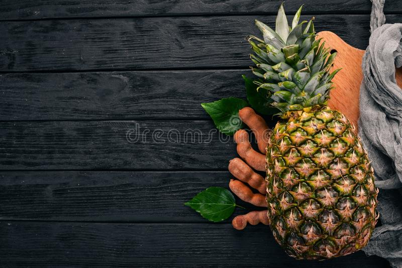 Pineapple. Tropical Exotic Fruits. On a wooden background. Top view. Copy space stock photography