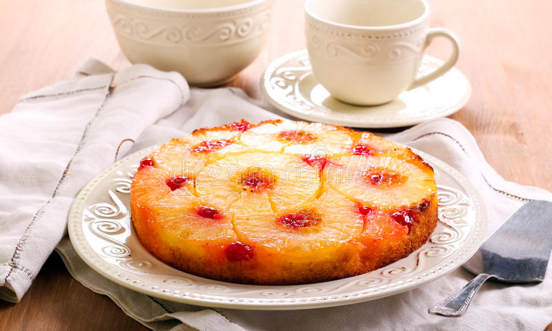 Pineapple upside down cake. With cherry glace royalty free stock photo