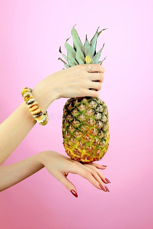 Pineapple in women hands stock image
