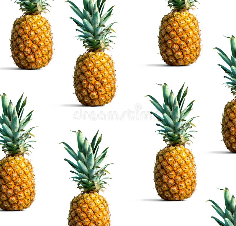 Pineapples on a solid color background. Many pineapples on a solid color background royalty free stock photo