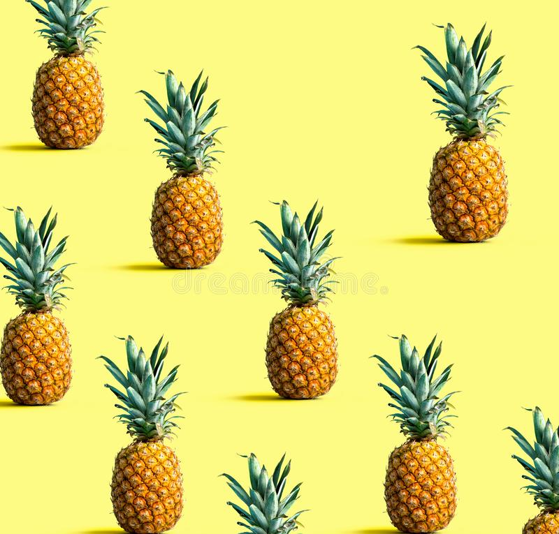 Pineapples on a solid color background. Many pineapples on a solid color background stock photography