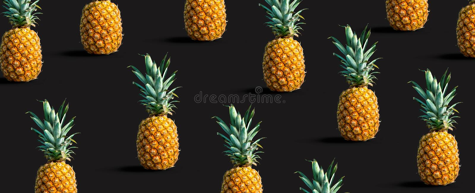 Pineapples on a solid color background. Many pineapples on a solid color background royalty free stock photography