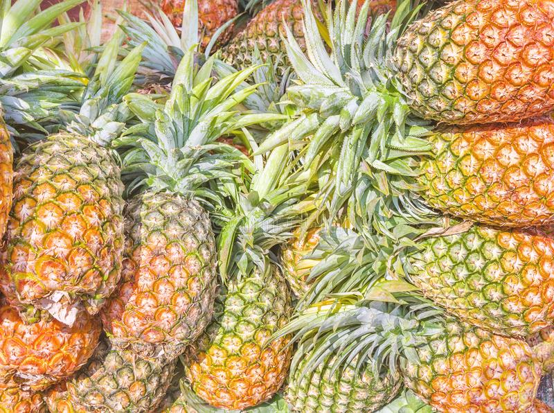Pineapples at street market background. Abstract photo of pineapples background at asia street market stock photo
