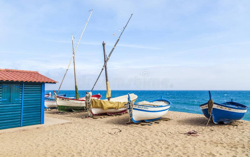 Pineda de Mar,Catalonia,Spain. Mediterranean beach and boats in Pineda de Mar, maresme region, province Barcelona, Catalonia royalty free stock photography