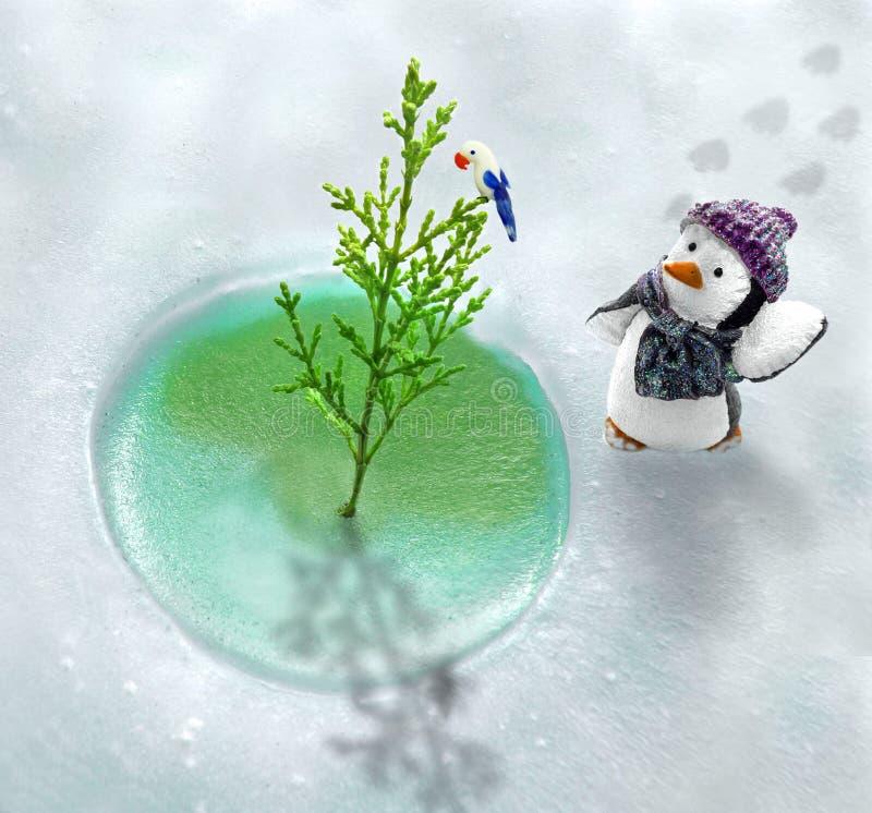 Pingüino y su mundo helado imagen de archivo libre de regalías