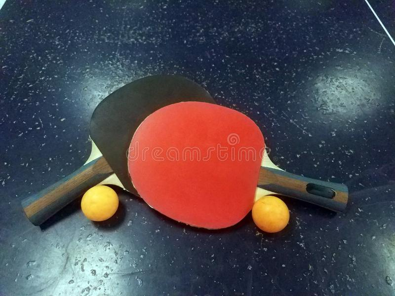 Ping pong paddles table tennis balls royalty free stock photography