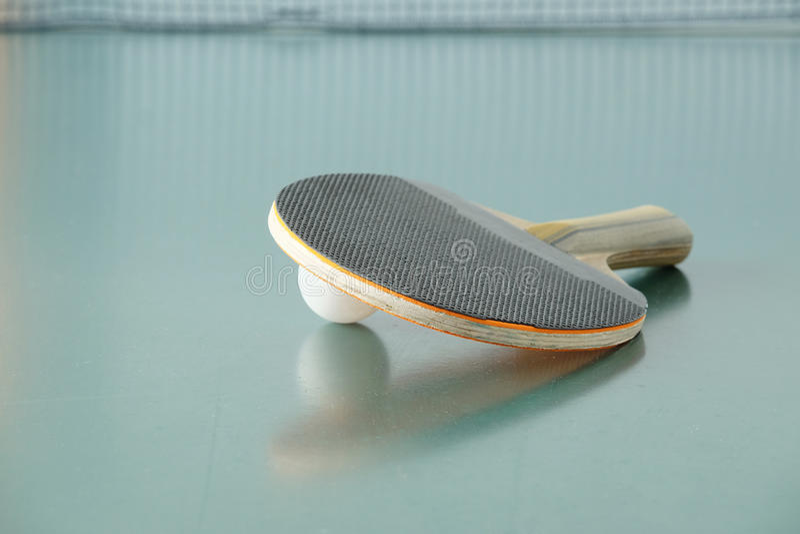 Ping-pong racket and a ball royalty free stock image