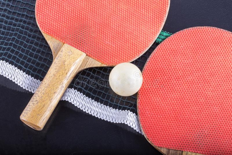 Ping pong rackets with ball and net stock images
