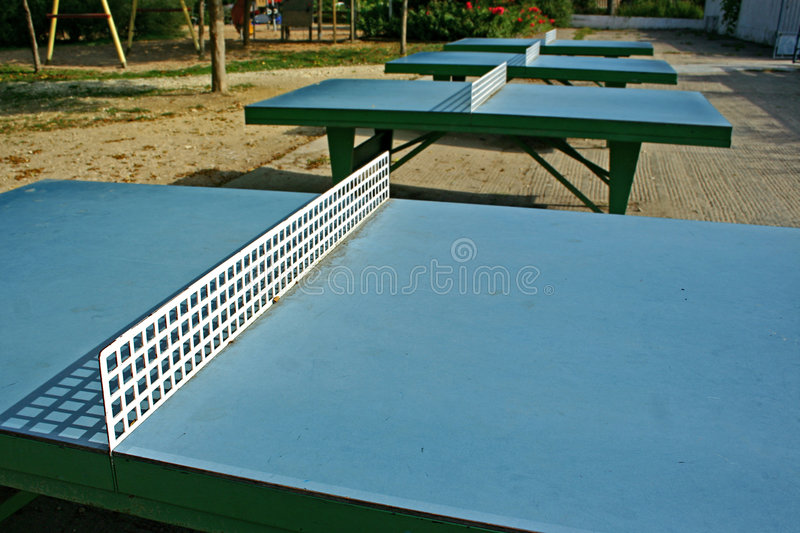 Ping pong tables stock images