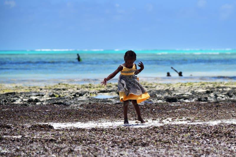 Little girl on Pingwe coastline, Zanzibar, Tanzania, Africa royalty free stock photo