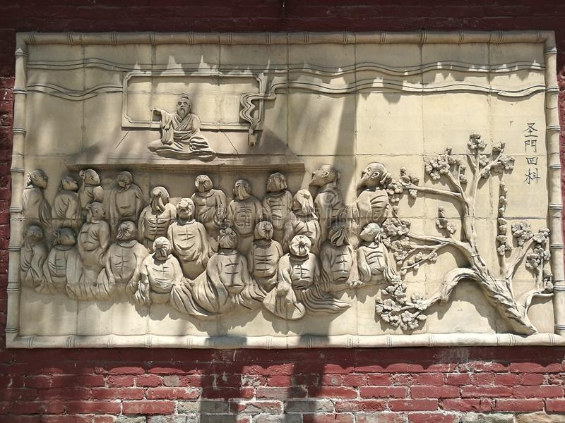 Pingyao Ancient City Teachings Art. A piece of art found in China`s Ancient Pingyao City. The stone art was made in a traditional Chinese style, depicting a royalty free stock images