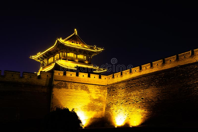 Pingyao, Shanxi province, China - The ancient walls protecting the Old city at night. Known as one of the best preserved villages of China, Pingyao is a UNESCO stock photo