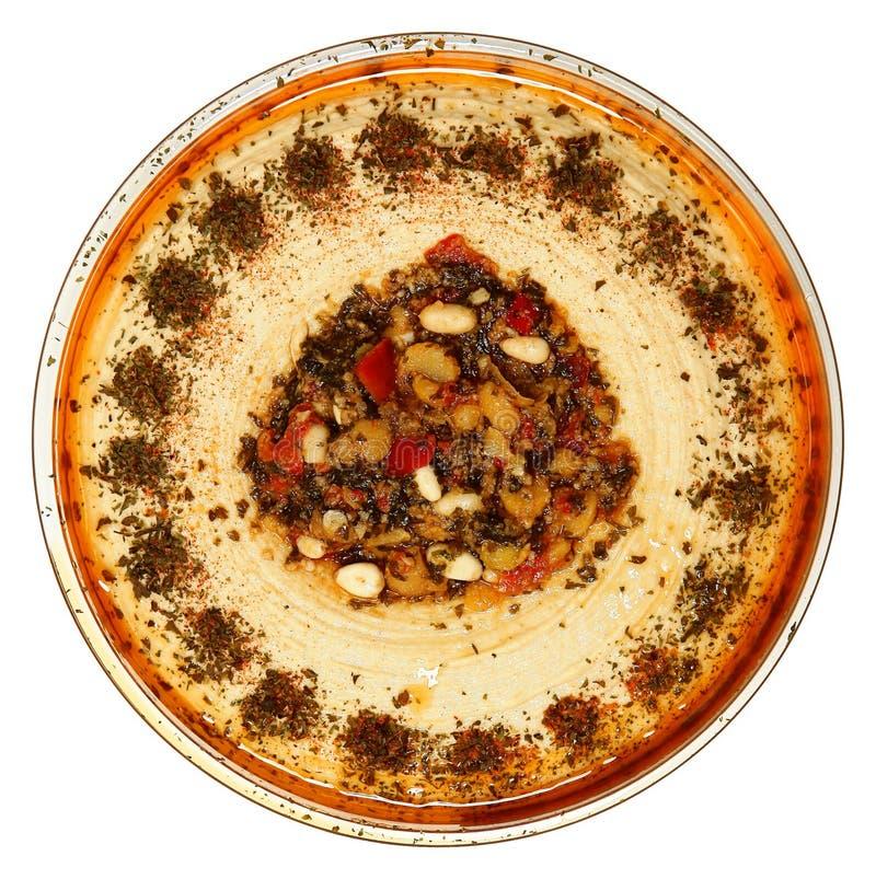 Pinhão Roasted Hummus na bacia de vidro. fotografia de stock royalty free