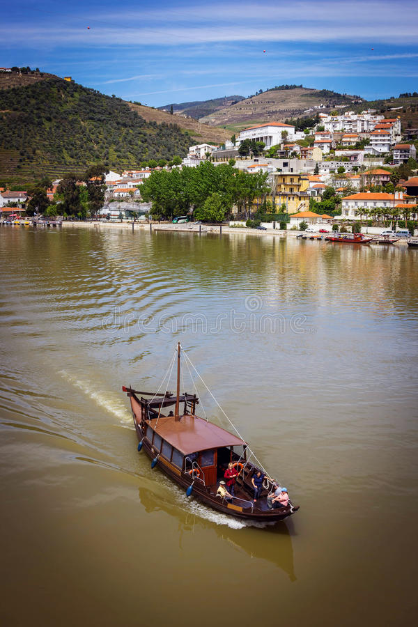 Pinhao village in Portugal. Douro valley and river with boat. View from Pinhao village in Portugal to Douro valley and river with boat stock image