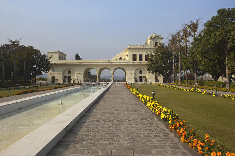 Pinjore Gardens Haryana Punjab. A picturesque view of the entrance to Pinjore Gardens Haryana with water fountains trees and colorful marigold flowers in front royalty free stock photo