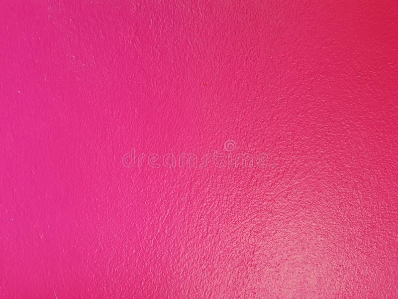 Pink color wall cement background royalty free stock photo