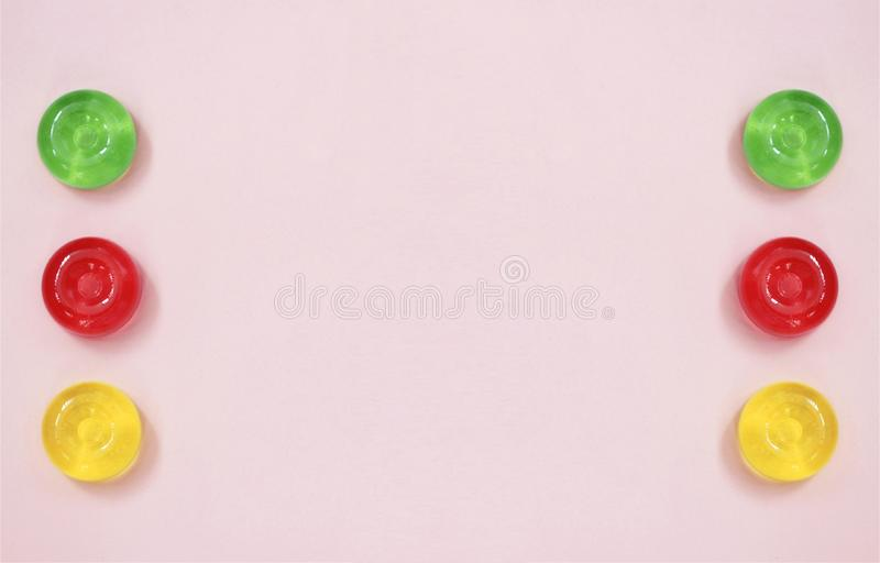 Pink abstract background with top view on colorful candy stock photography