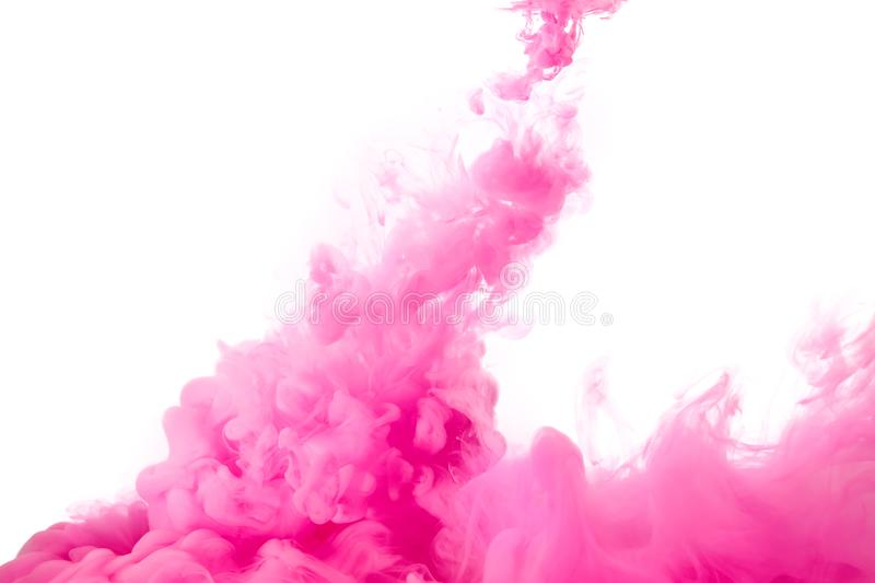 Pink Acrylic Ink in Water. Color Explosion. Paint Texture. Closeup of a colorful pink acrylic ink in water isolated on white with copy space. Abstract background royalty free stock images