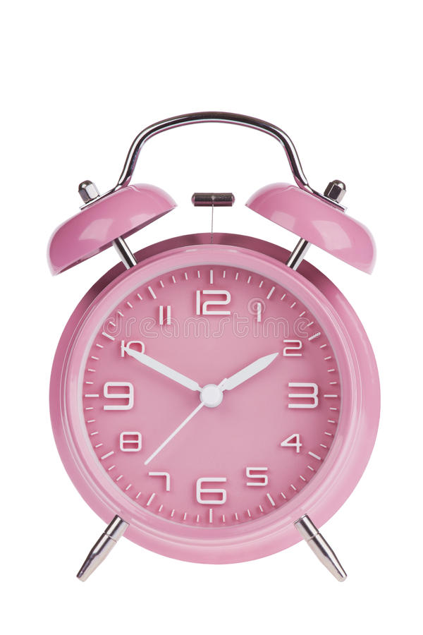 Pink alarm clock with the hands at 10 and 2 isolated on a white background royalty free stock photo