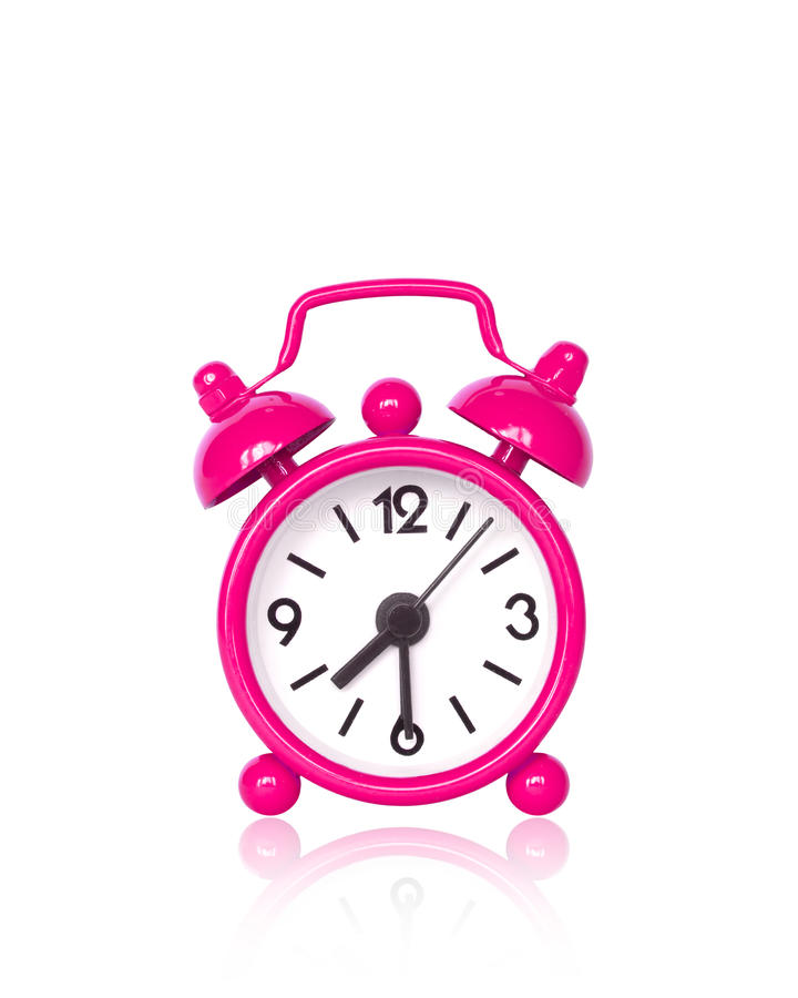 Pink alarm clock on white background. With copy space stock image