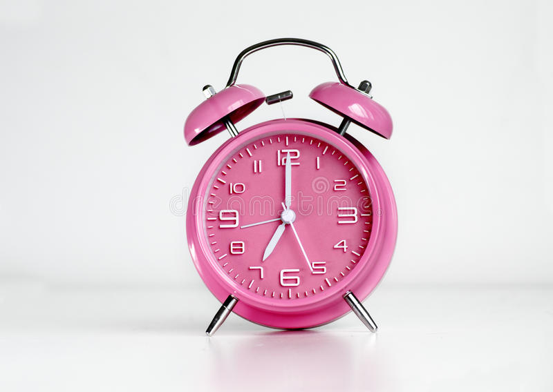 Pink analog retro twin bell alarm clock. Isolated royalty free stock photos