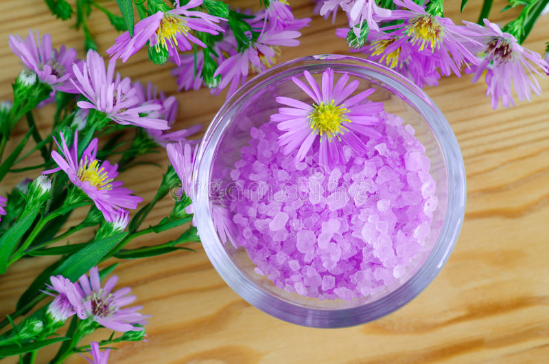 Pink aroma bath salt with flowers extract. Top view royalty free stock photo