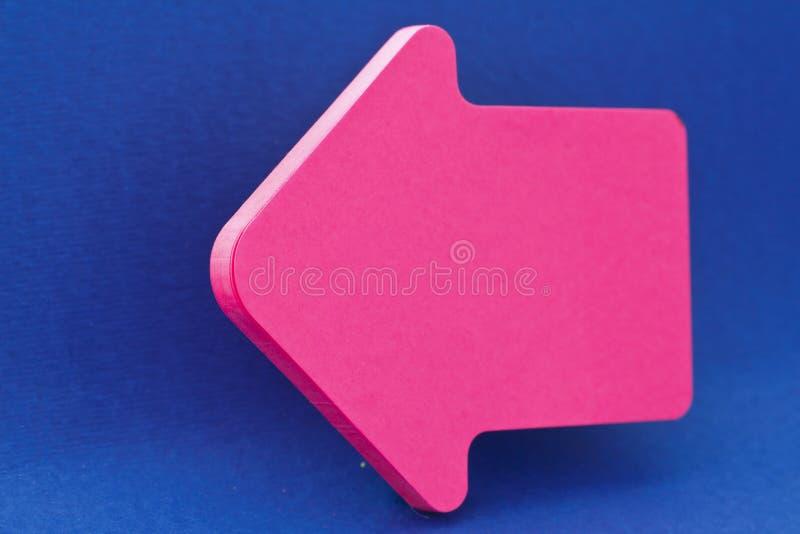 Pink Arrow On Blue Royalty Free Stock Photos