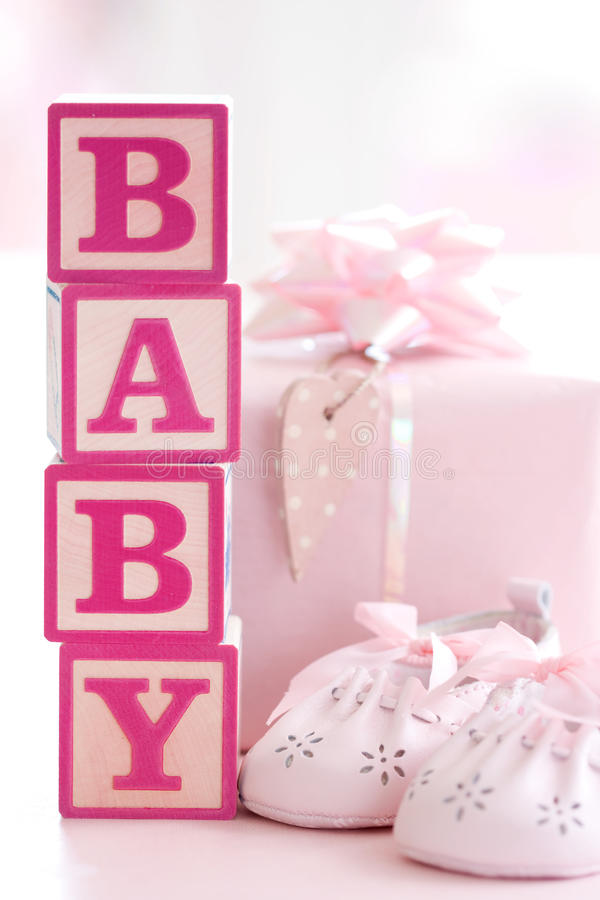 Pink baby building blocks. Concept shot for baby shower or new baby royalty free stock images