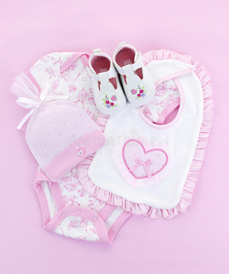 Pink baby clothes for infant girl stock photos
