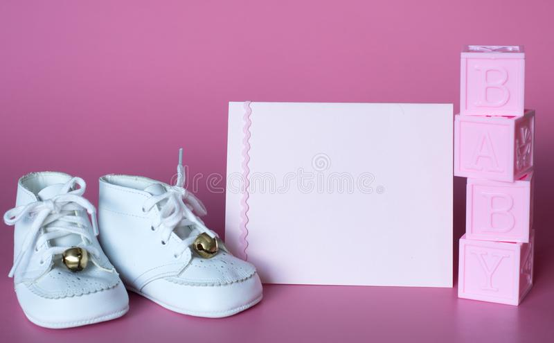Pink Baby Girls Baby Shower or Birth Announcement Card with Vintage Shoes and Blocks. Horizontal photo with side angled view and. With room or space for copy royalty free stock photos