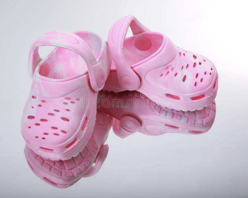 Pink baby sandals royalty free stock photography