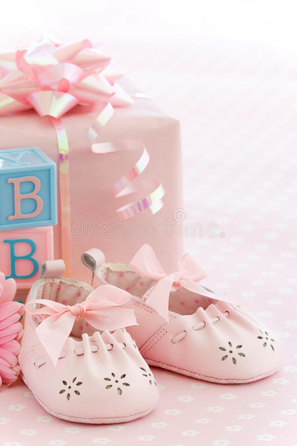 Pink baby shoes. Baby shower for a baby girl royalty free stock photos