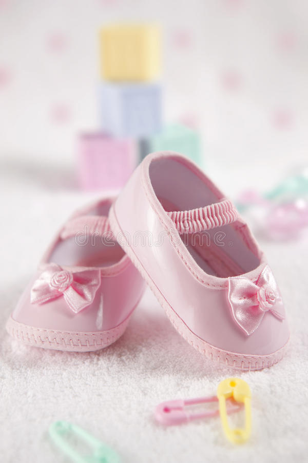 Pink baby shoes. Close-up of a pink baby shoes royalty free stock image