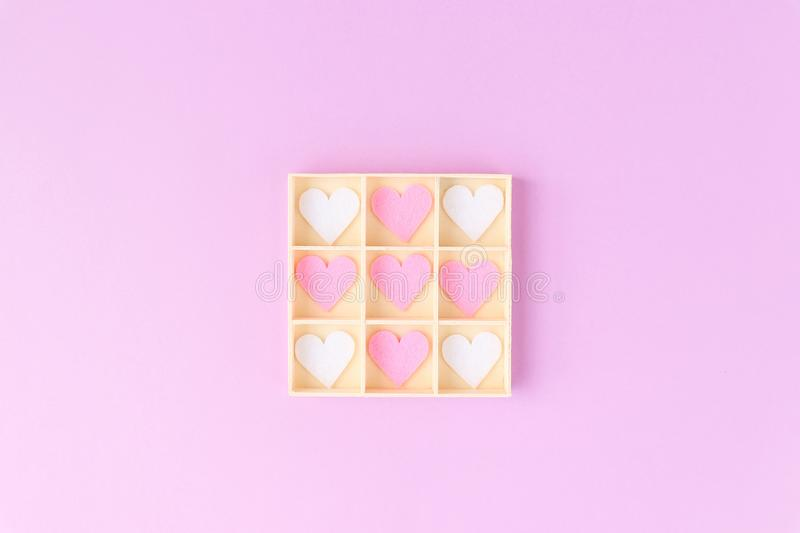Pink background. Beautiful decorative pink and white hearts in a wooden box. Pink concept royalty free stock photography